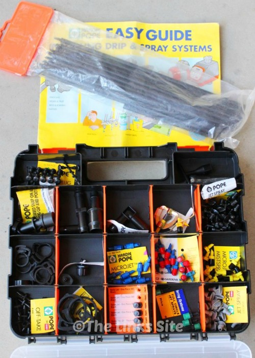 The small compartments of this storage box are great for organising all of my garden irrigation supplies!